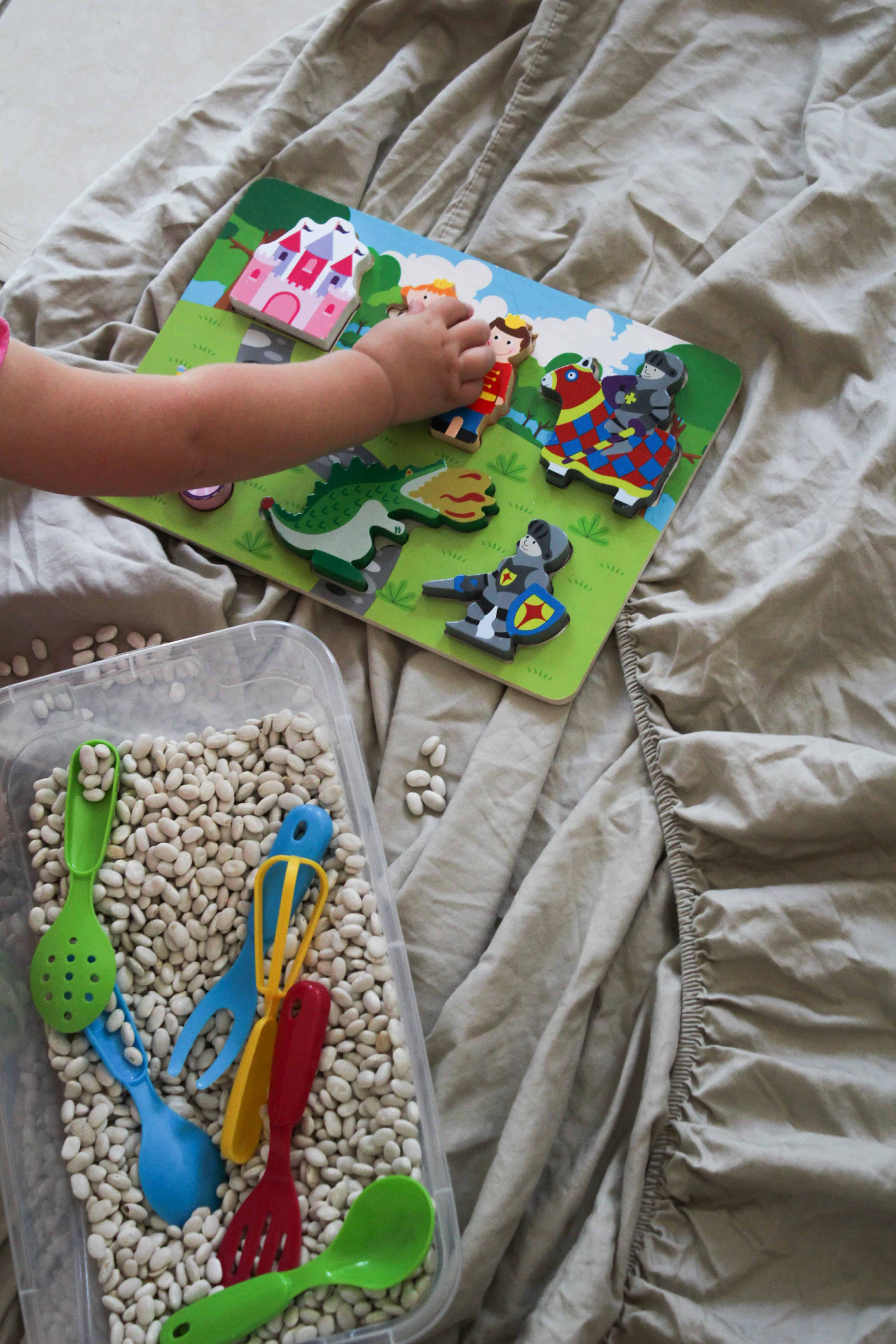 Sensory Play activities for toddlers. Add fun elements like puzzles to the sensory box. Sensory boxes incorporating a few ideas to enhance the play-based-learning experience.