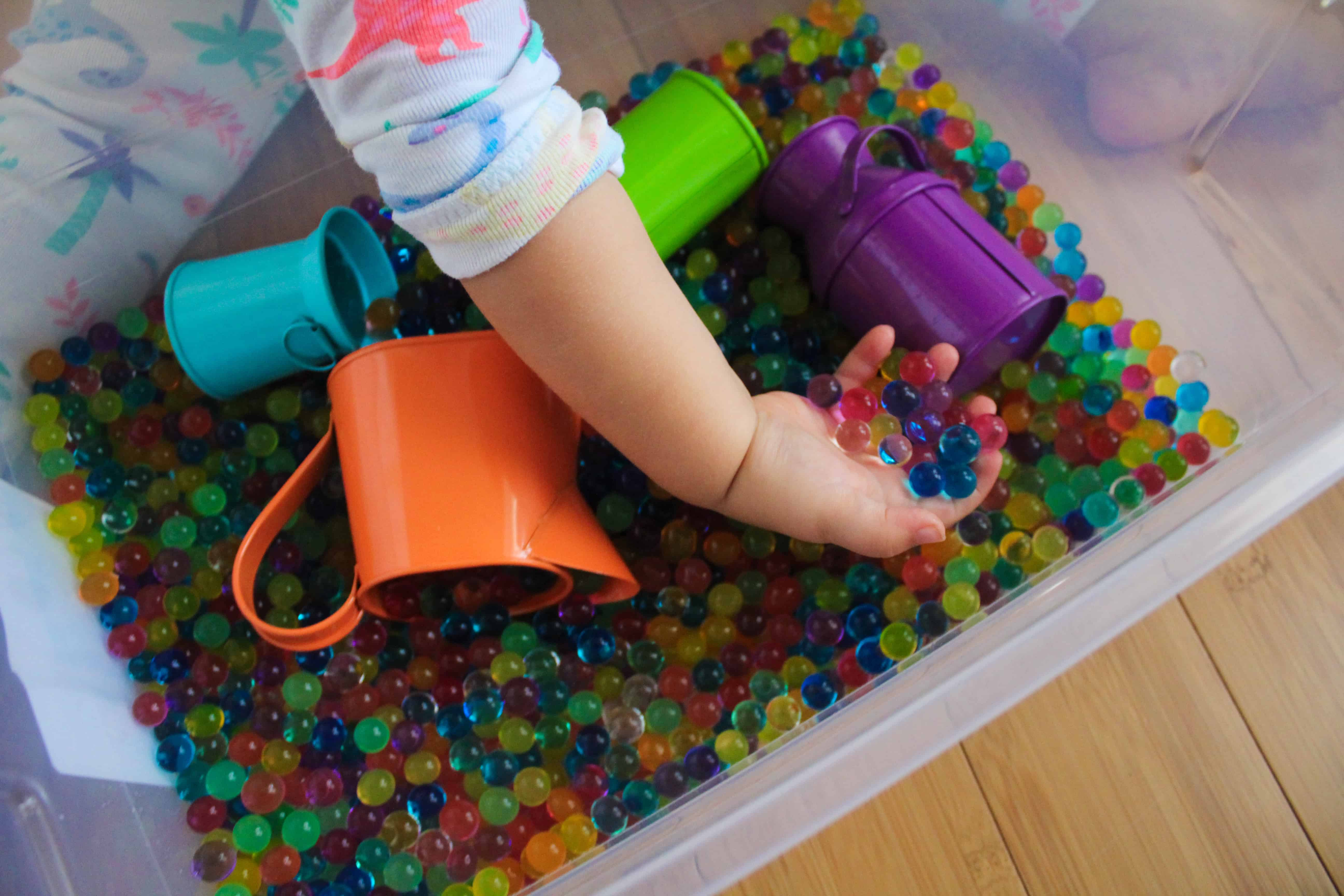 Water bead are a fun toddler activity and a great addition to a sensory box. Teach your child colors and counting through this fun play-based activity. Great indoor activity for toddlers and preschool aged children,