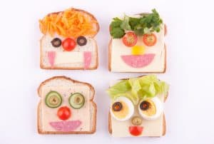 Easy ways to make food fun for kids. Transform sandwiches into food faces using a variety of items you already have.