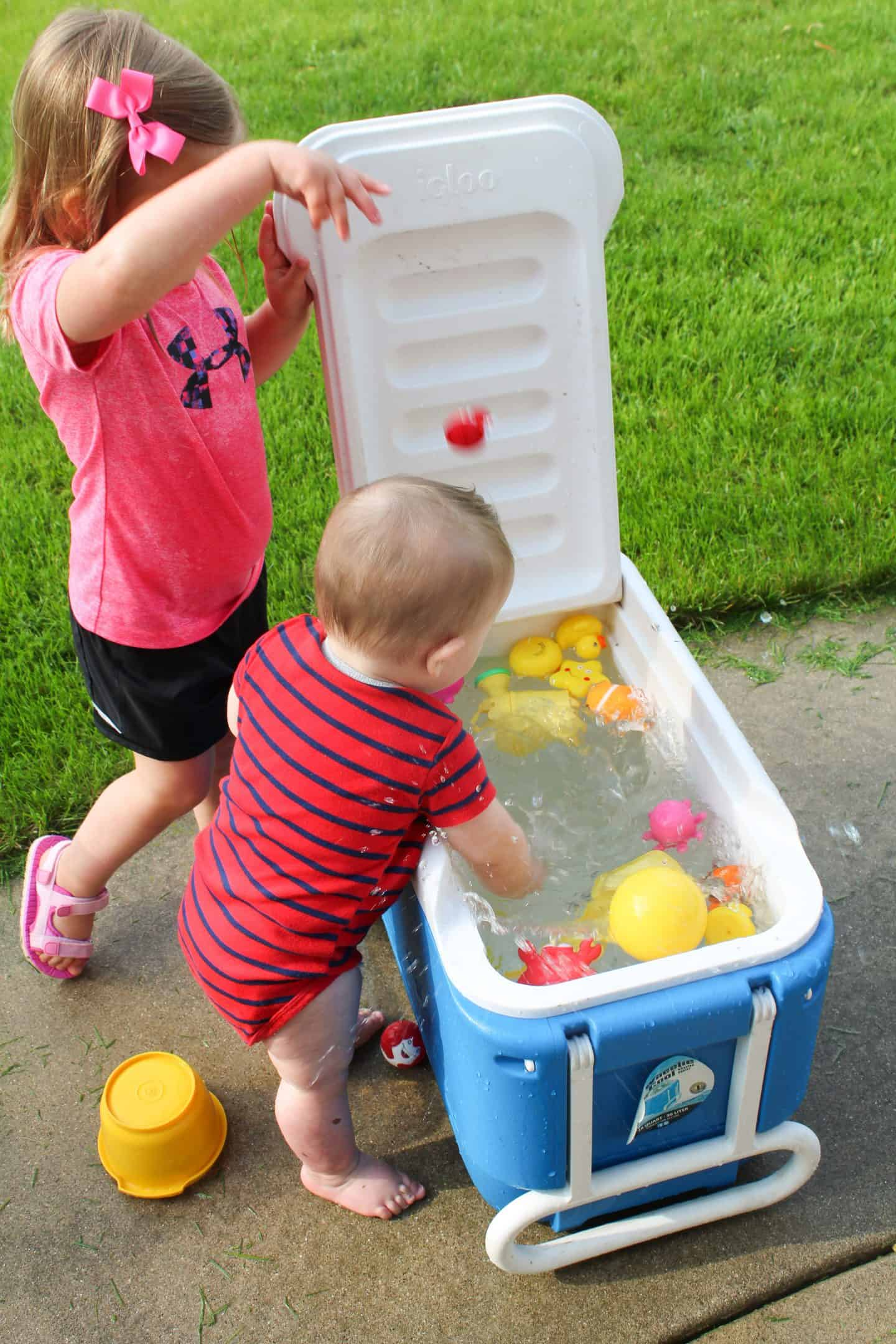 Turn a cooler into a fun water center for your preschool aged child. Add water and allow them to play with the water table for tons of summer fun #watertable #preschoolideas #preschoolactivities