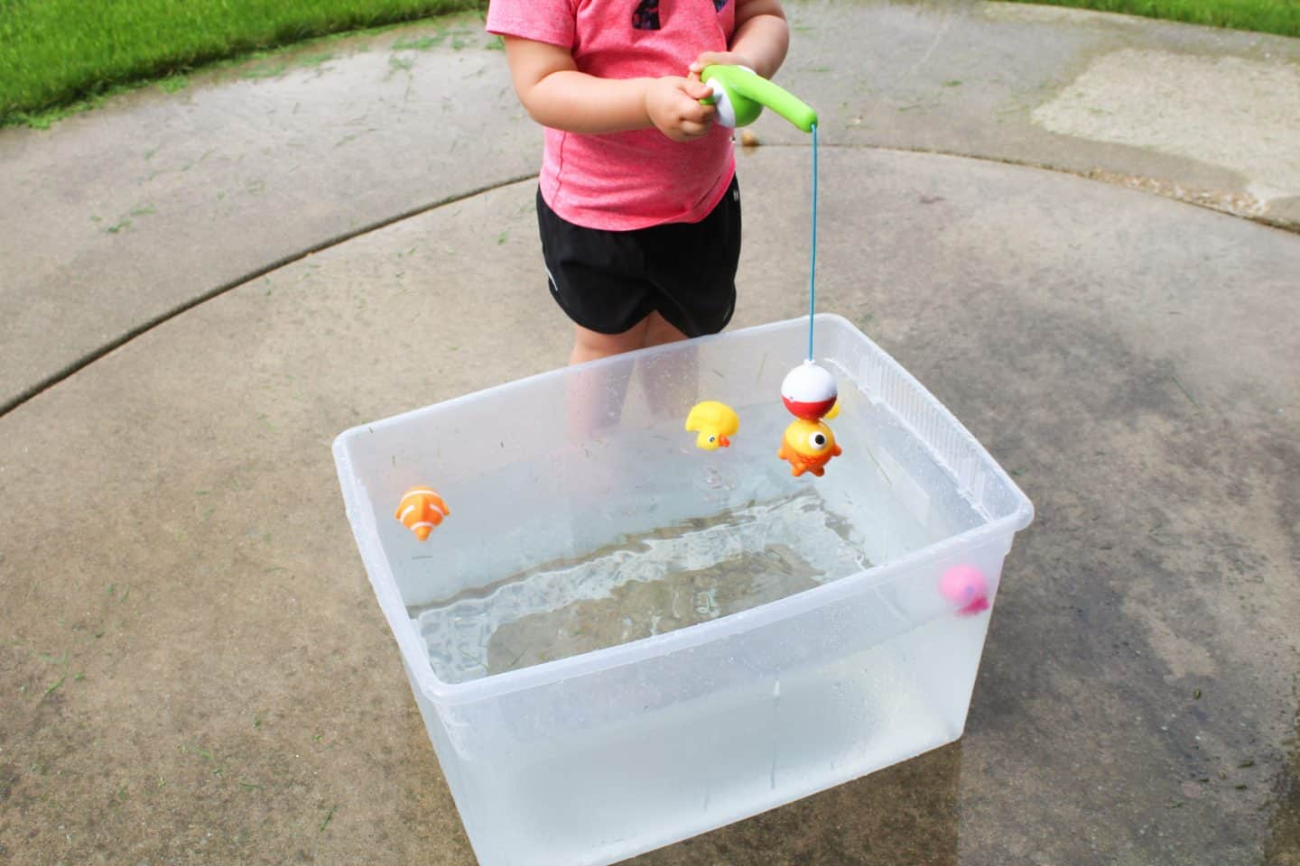 Fishing in a water table. A fun preschool water activity for preschool ages children. Fun and easy summertime ideas #waterplay