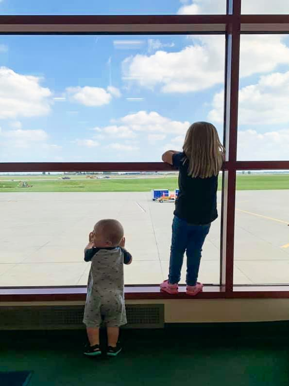 Traveling with a baby and a toddler on an airplane and other tips and tricks for family vacations